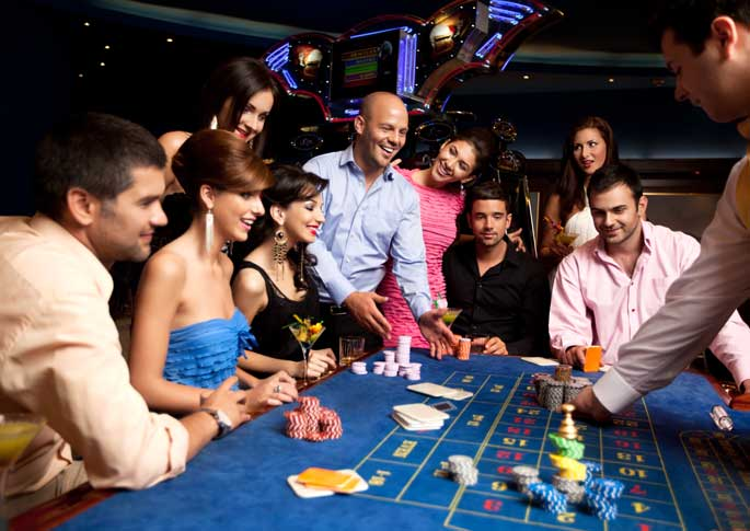 Group Having Fun Playing Roulette During Casino Party Rental